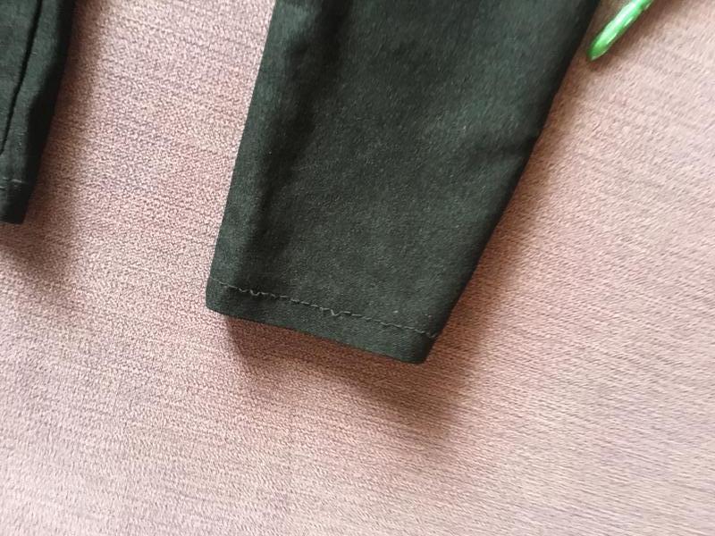 Актуальные штаны со рваностями и высокой посадкой - Фото 2