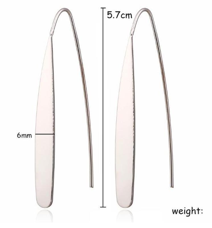 Длинные оригинальные серьги серебристого цвета - Фото 4