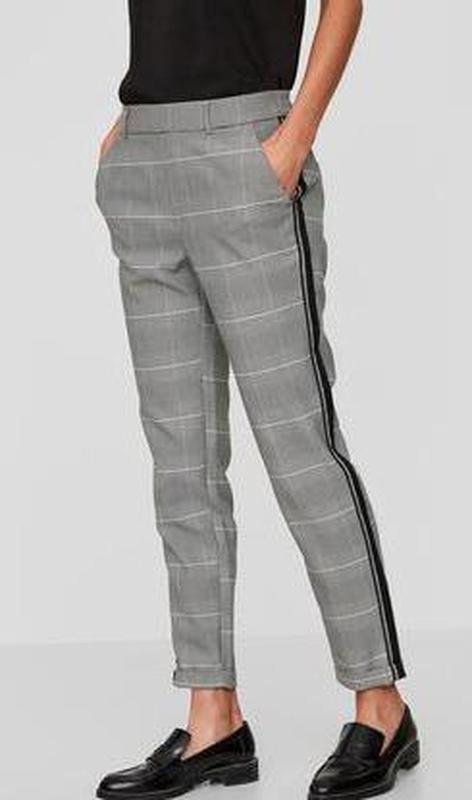 Шикарные трендовые стильные модные меланжевые брюки в клетку с...