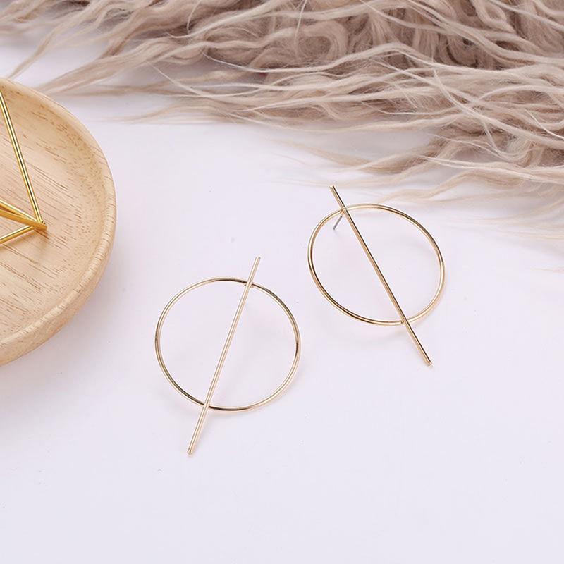 Серьги большие кольца золотистого цвета - Фото 3
