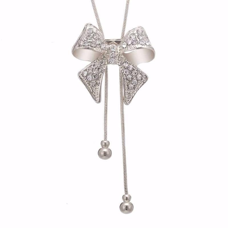 Длинная цепочка ожерелье с подвеской бантик серебристого цвета - Фото 2