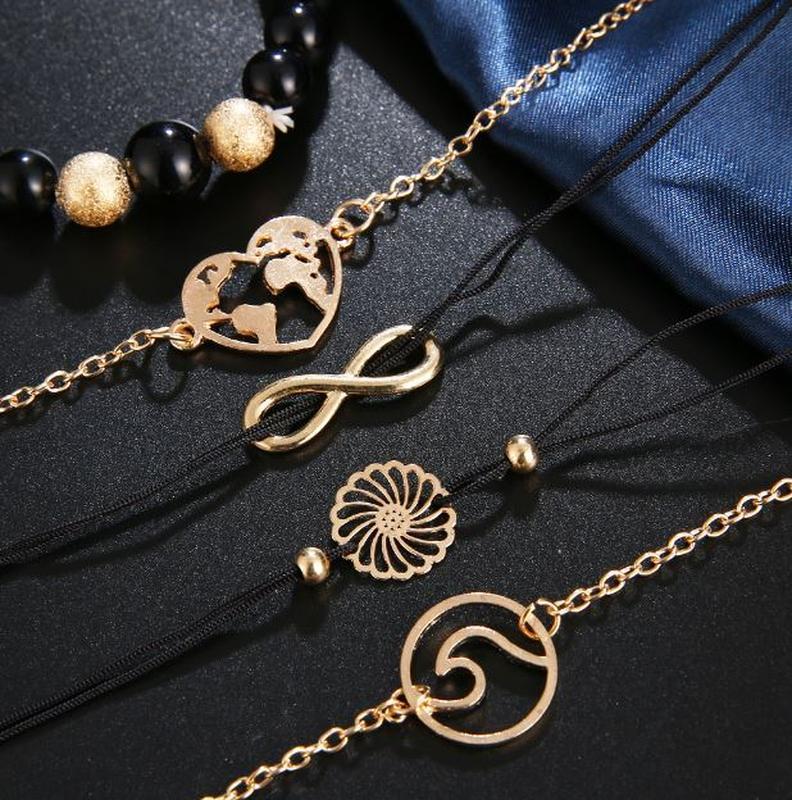 Набор браслетов черного цвета 5 штук ( с подвесками цветок, се... - Фото 3