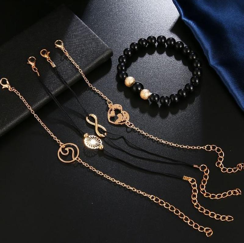 Набор браслетов черного цвета 5 штук ( с подвесками цветок, се... - Фото 4