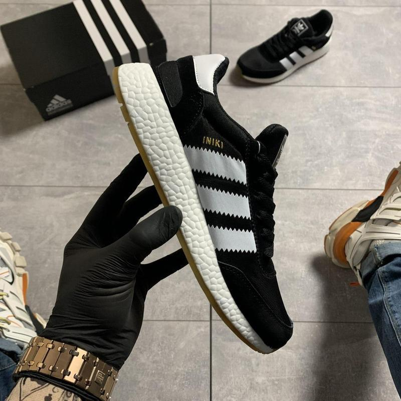 Adidas iniki black and white.
