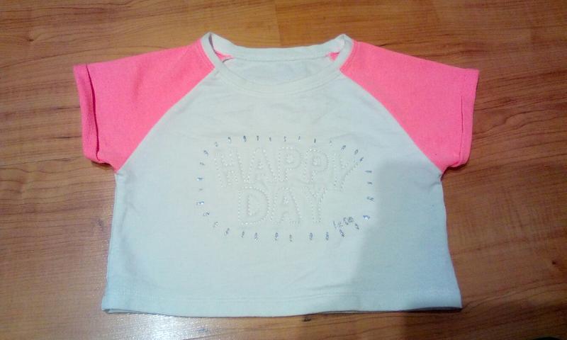 Модная короткая футболочка на 6-9 лет