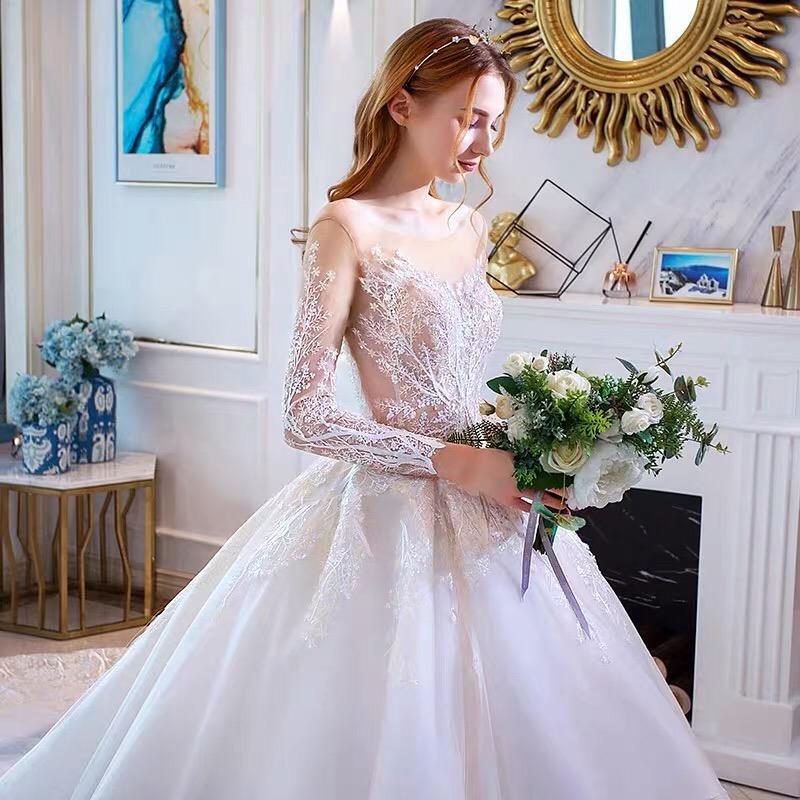 Розкішна весільна сукня на довгий рукав