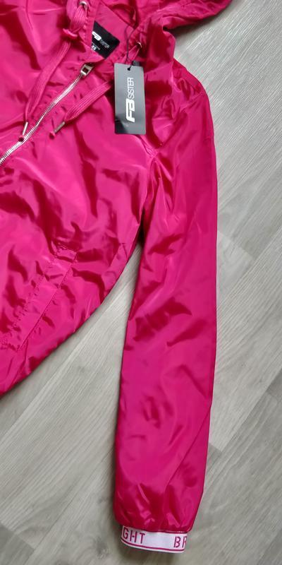 !продам новую женскую спортивную лёгкую куртку ветровку с капю... - Фото 4
