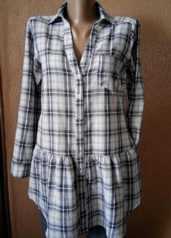 Рубашка удлиненная с боковыми карманами,воланом по низу размер...
