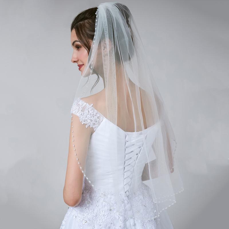 Свадебная фата с жемчужными бусинами по краю