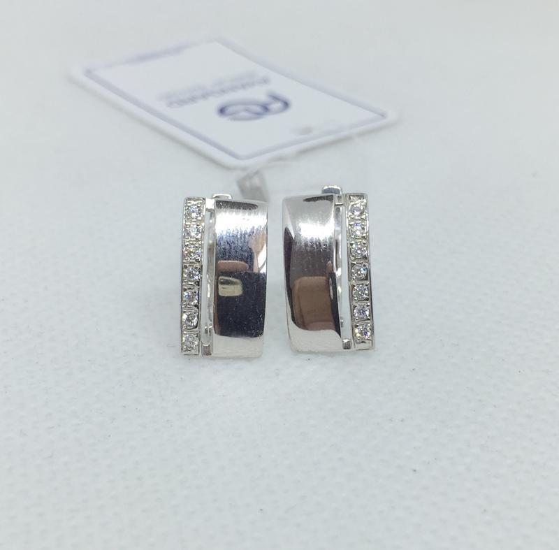 Новые родированые серебряные серьги фианиты серебро 925 пробы