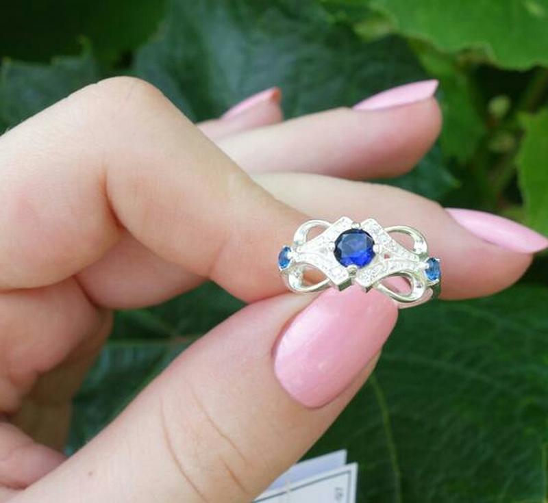 Кольцо ажурное с камнями