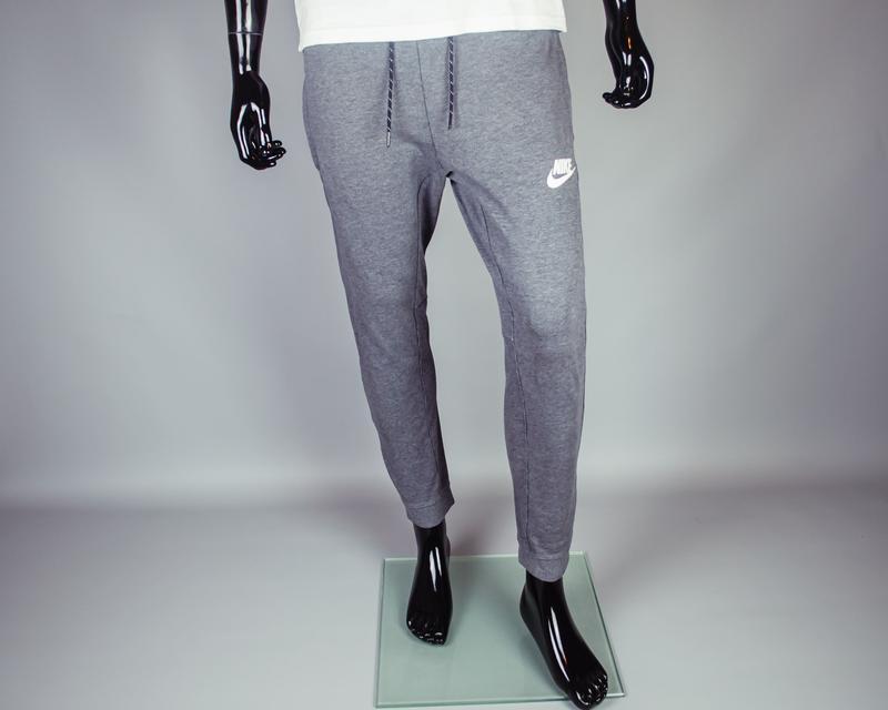 Фирменные зауженные спортивные штаны на манжетах nike m nsw. с...