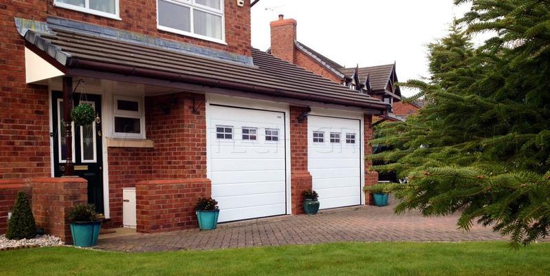 Секційні ворота в гараж з вбудованими вікнами (акрилове склінн... - Фото 2