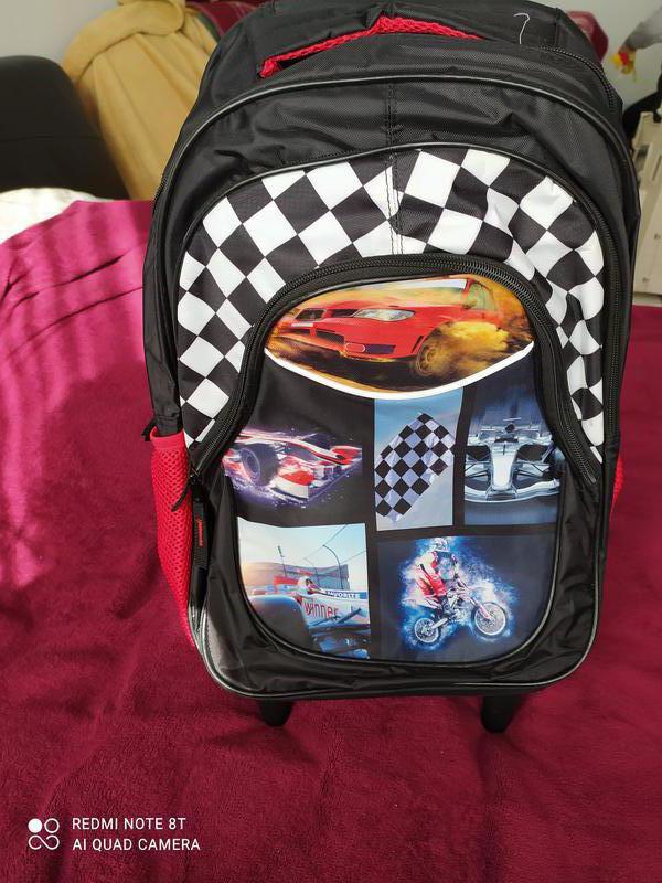 Новый рюкзак на колесах и на плечи мальчик для школы и поездок