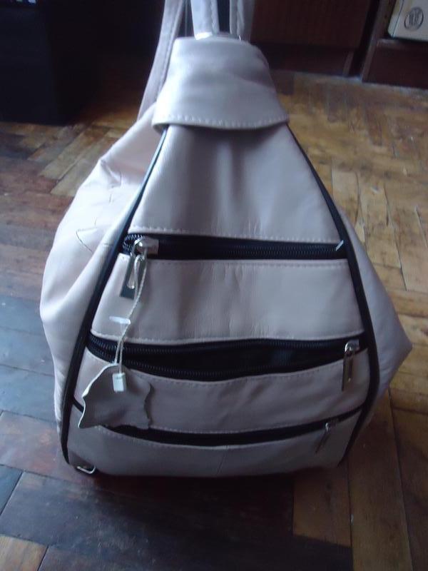 Большая вместительная кожаная сумка рюкзак. сумка трансформер