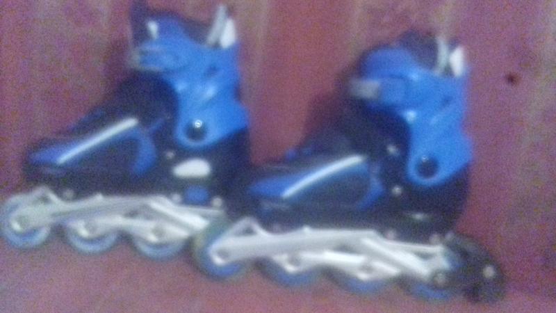 Роликовые коньки
