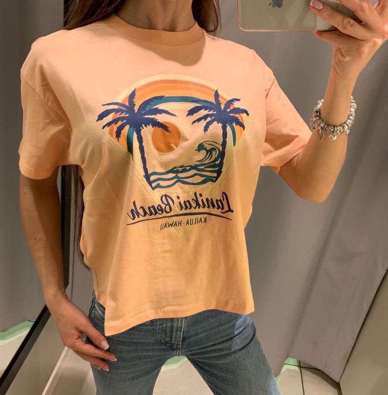 Оранжевая футболка с пальмами reserved есть размеры