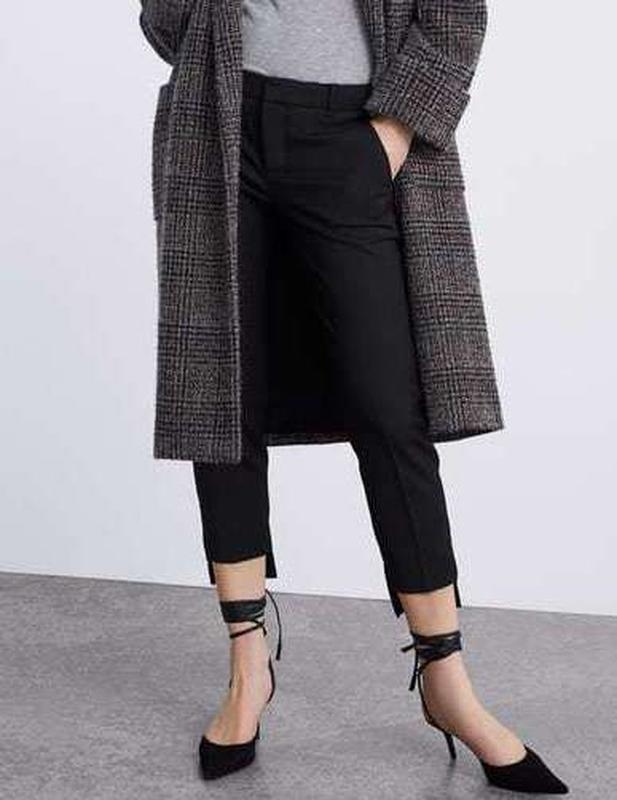 Фирменные шикарные стильные модные укороченные брюки с неровны...