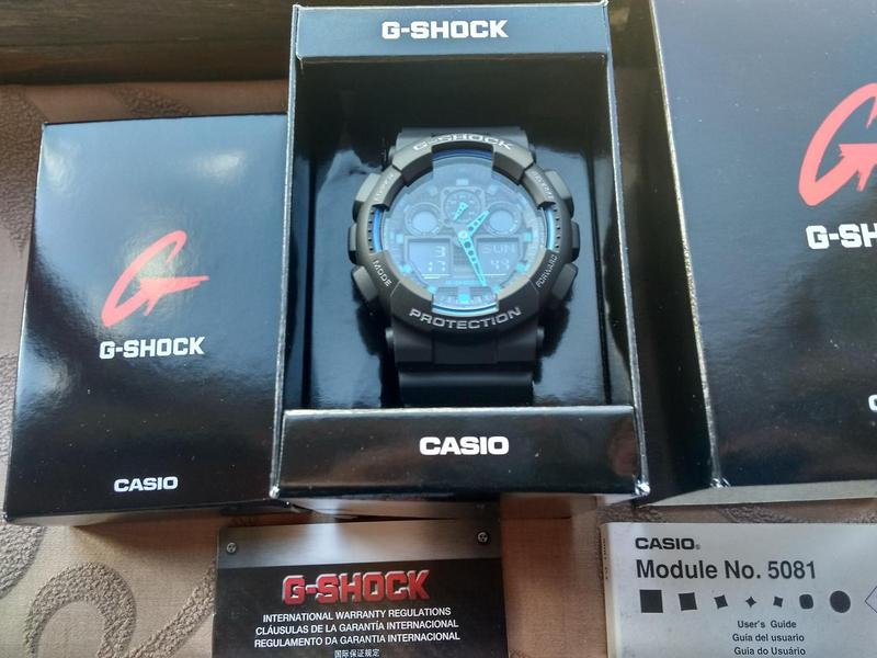 Часы Casio G-shock GA-100-1A2 черные с синими вставками новые