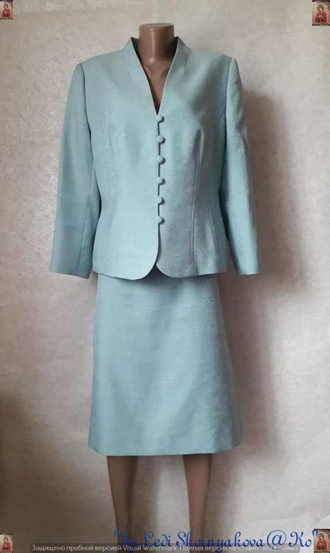 Новый нарядный костюм с люрексной нитью нежного голубого цвета...
