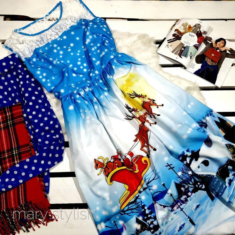 Новогоднее платье с очень красивый рисунком на всю юбку платье...