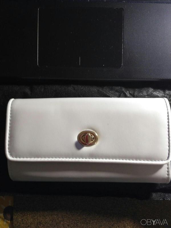 Стильный светло- серый кошелек под купюру Орифлейм.