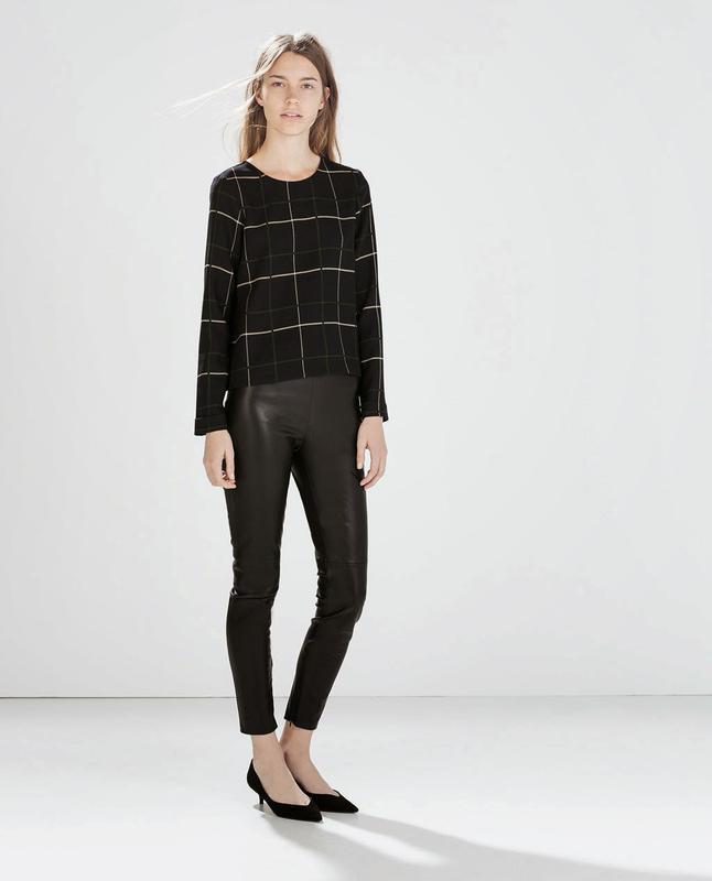 Элегантная блуза в клетку с молнией на спине