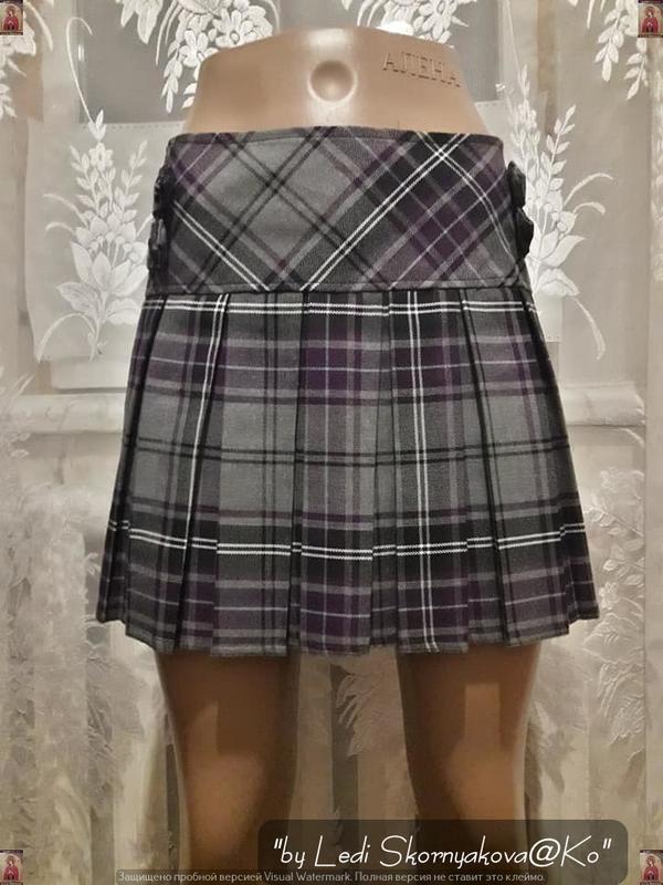 Новая стильная аккуратная мини-юбка плиссе в крупную серую кле...