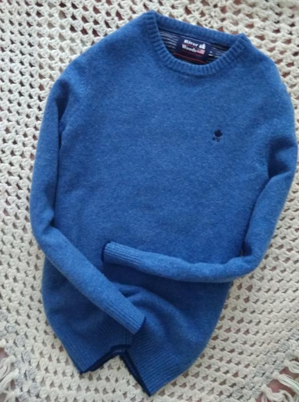Невероятно красивий,теплий свитер в голубом цвете.100%lana wool.