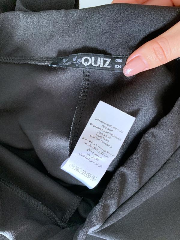 Укорочённые брюки с воланами - Фото 5